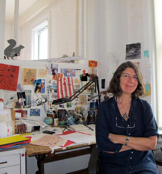 Jessie Hartland at her desk.